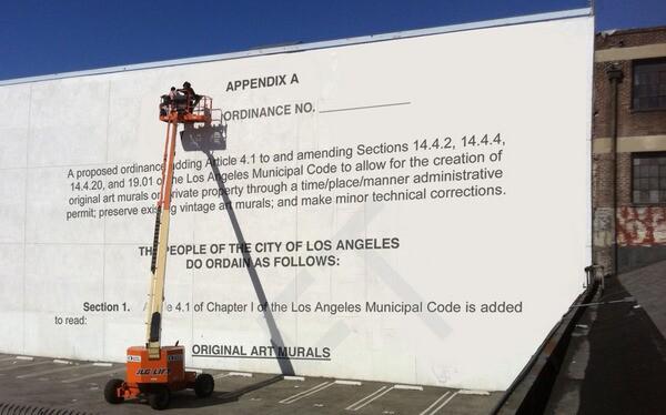 Writing on the wall, a digitally illustrated mock mural I Photo Ilustration by Ed Fuentes. Base photo courtesy of Jet Set Graffiti