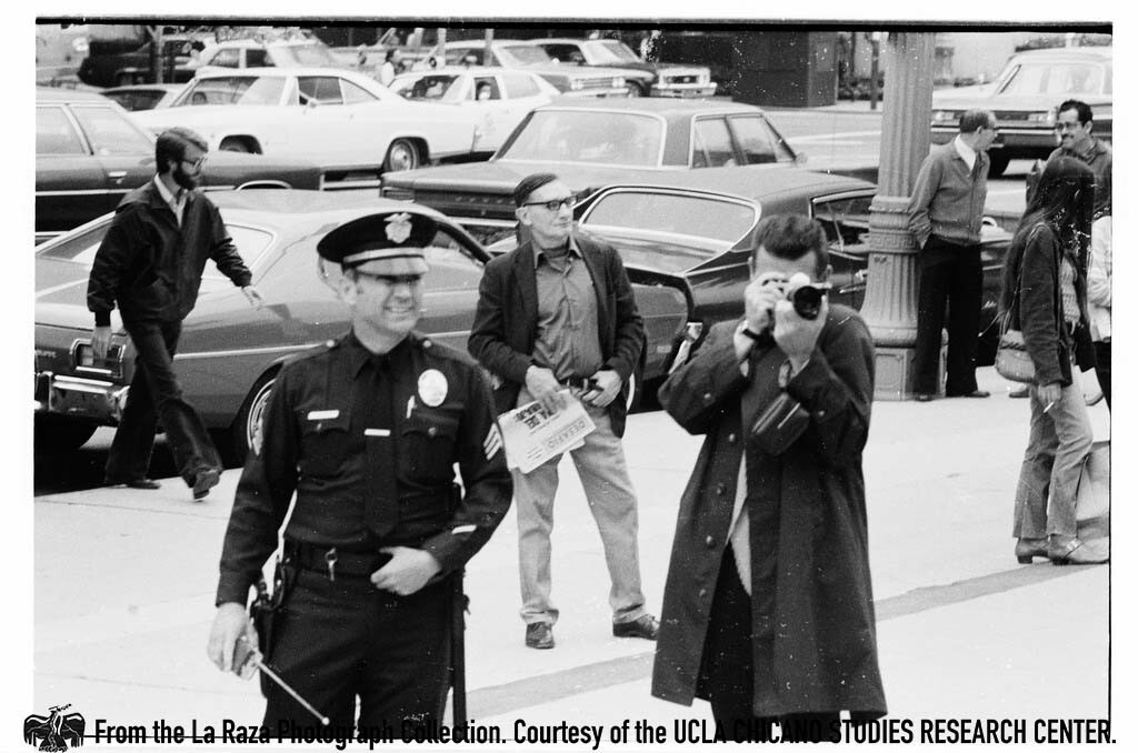 CSRC_LaRaza_B16F6C14_Staff_014 Man photographs protesters against Rodino Bill | La Raza photograph collection. Courtesy of UCLA Chicano Studies Research Center