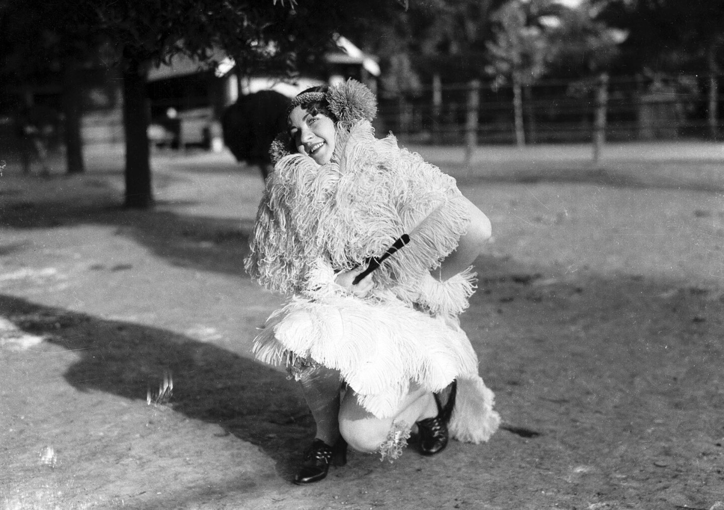 A woman models an ostrich feather stole