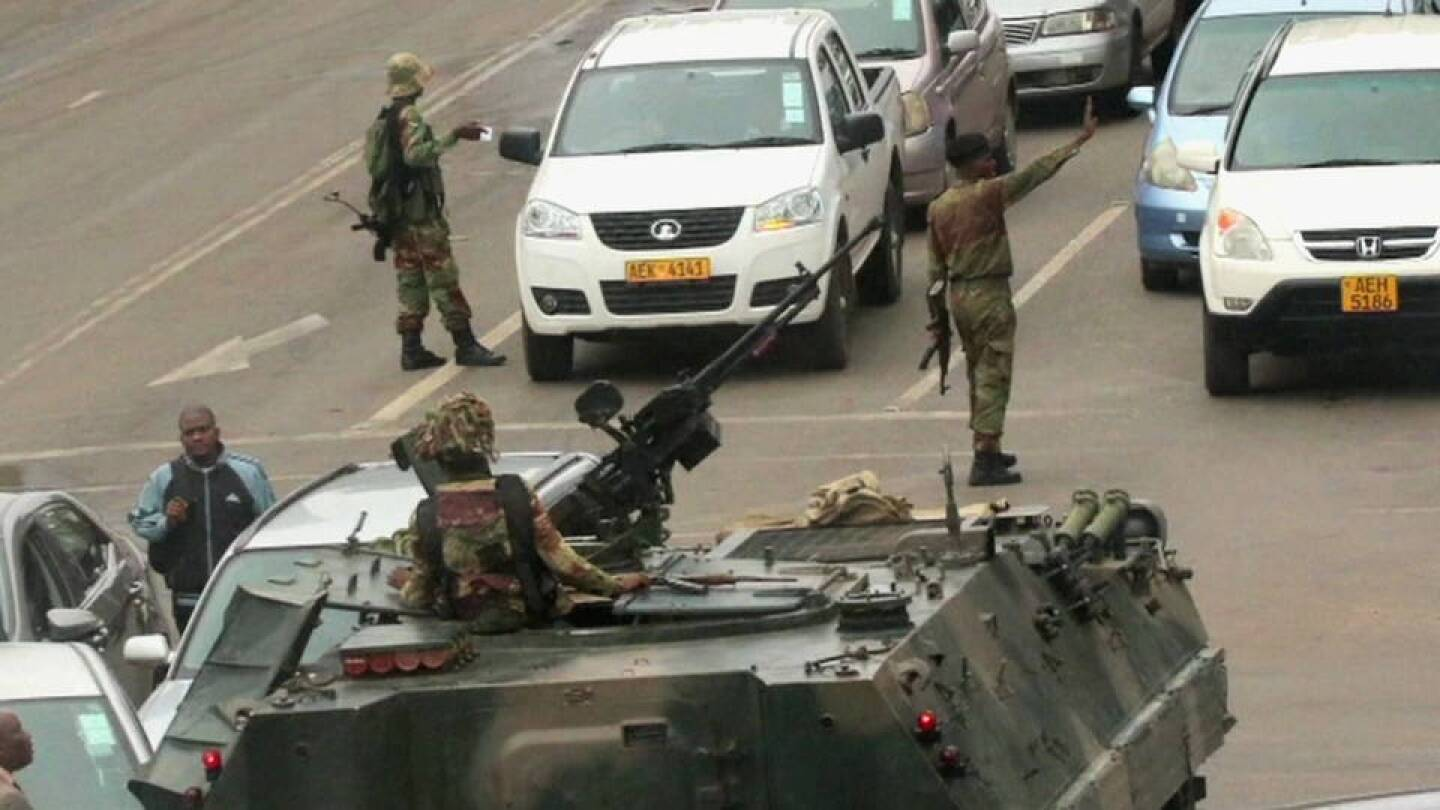 Military tanks and personnel in the streets of Zimbabwe. | Democracy Now