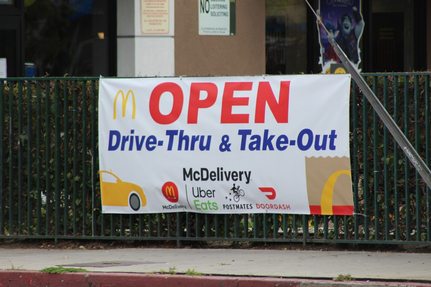 "McDonald's sign reading ""Open Drive-Thru & Take-Out"" 