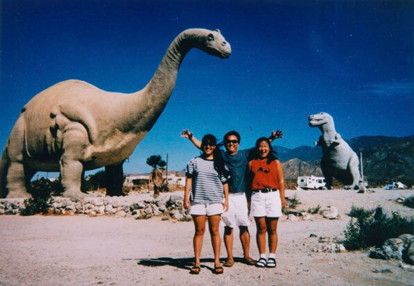 A family visits Claude Bell's Cabazon dinosaurs in 1994. Courtesy of the Shades of L.A. Collection, Los Angeles Public Library.
