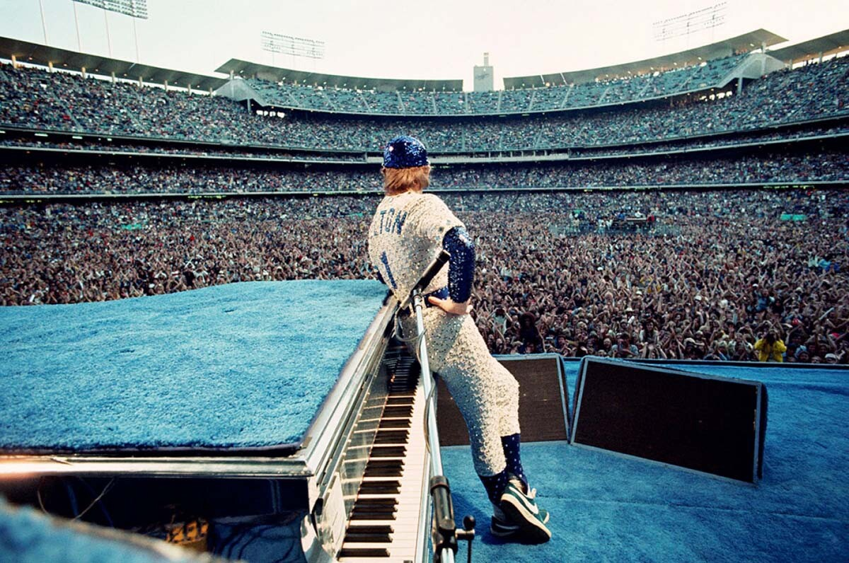 Signed limited edition print by Terry O'Neill. Elton John performs at Dodger Stadium in Los Angeles, October 1975 | Courtesy of Modern Rocks Gallery
