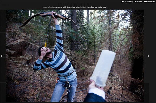 A friend of Trev Lee uses an arrow to secure rope for climbing a Giant Sequoia in Yosemite National Park.