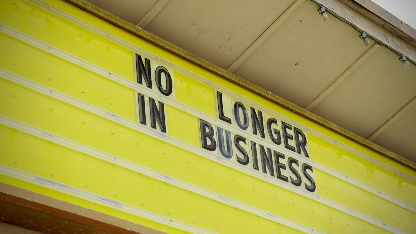 "A marquee reads ""No longer in business."" 