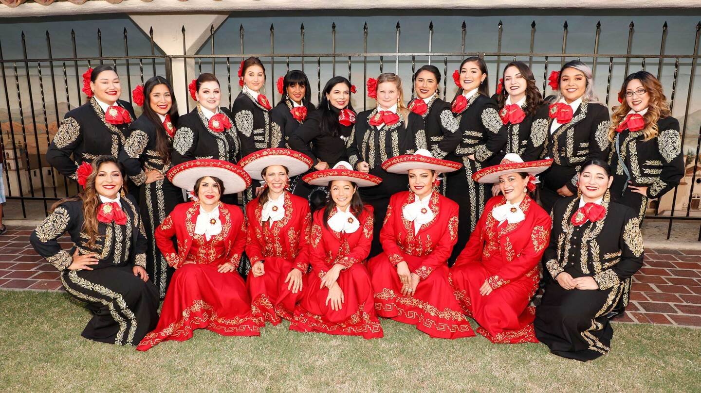 Mariachi Divas de Cindy Shea (top row), Leonor Xochitl Perez, Ph.D. (top row, sixth, clockwise) and Las Adelitas (bottom row, in red) in London at the International Mariachi Women's Festival, July 21, 2018. | Eddie Sakaki Photographer