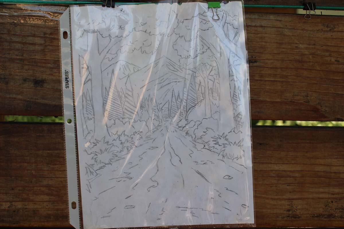 A drawing of a forest hangs on Dan Fields' Los Feliz fence gallery.