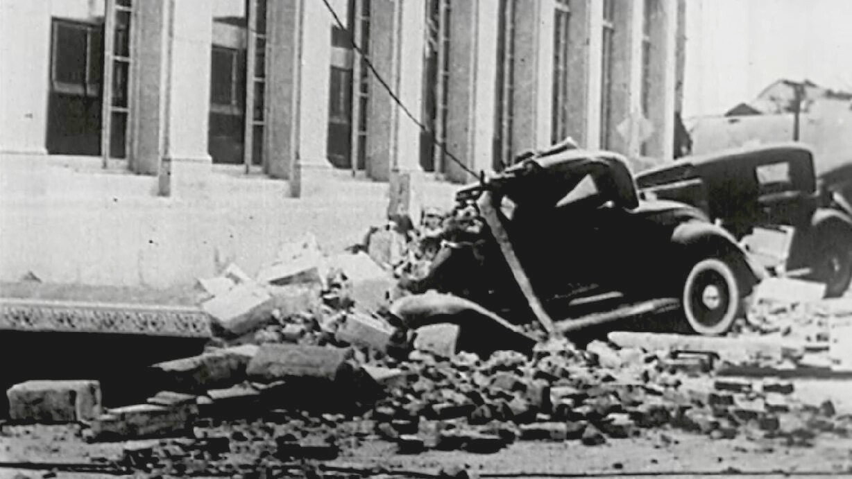 Car buried under bricks from collapsed building following the 1933 Long Beach Earthquake.
