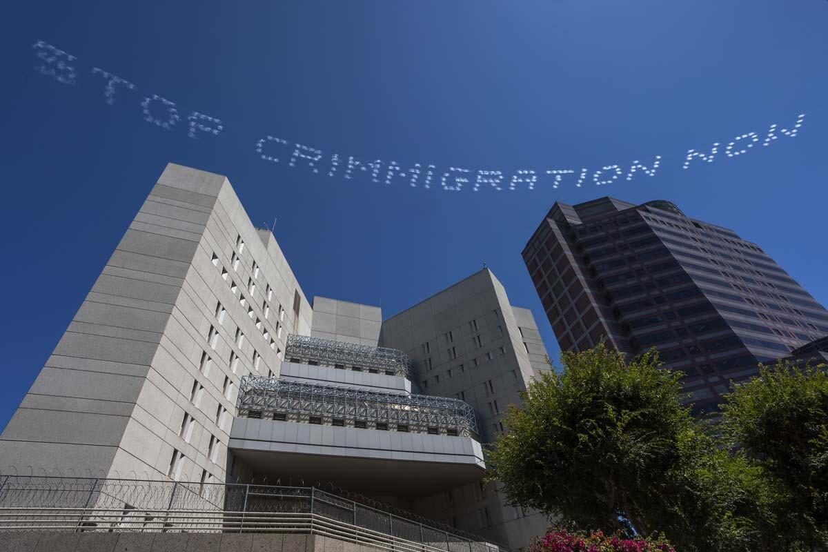 """""""STOP CRIMMIGRATION NOW"""" written in in the sky, contributed by Bamby Salcedo over the ICE L.A. Field Office 