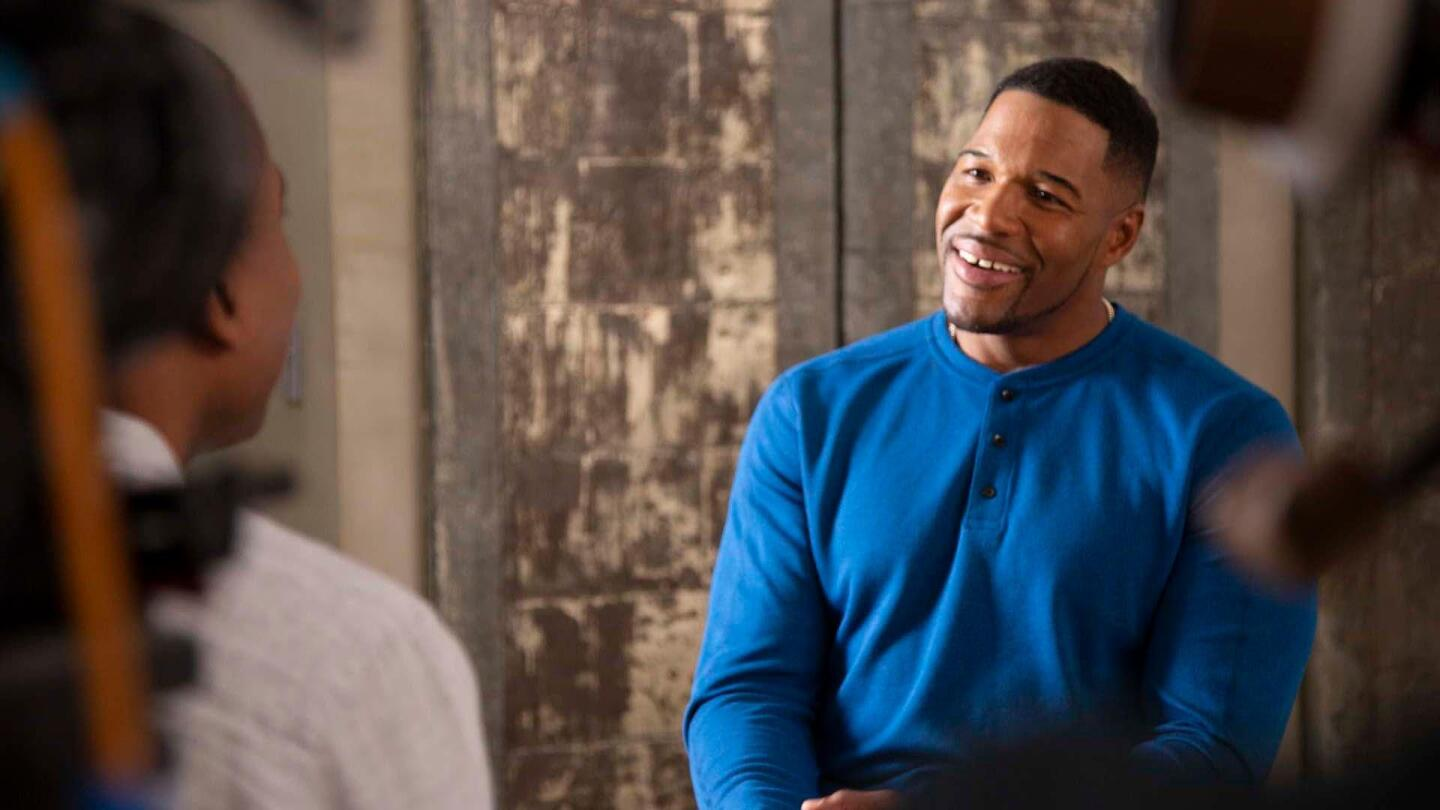 "Michael Strahan sitting down in an interview on ""Breaking Big"""