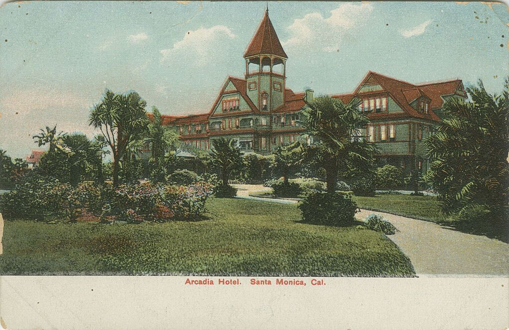 View of the Arcadia Hotel in Santa Monica, with gardens and a lawn in the foreground. |  Courtesy Werner von Boltenstern Postcard Collection/William H. Hannon Library