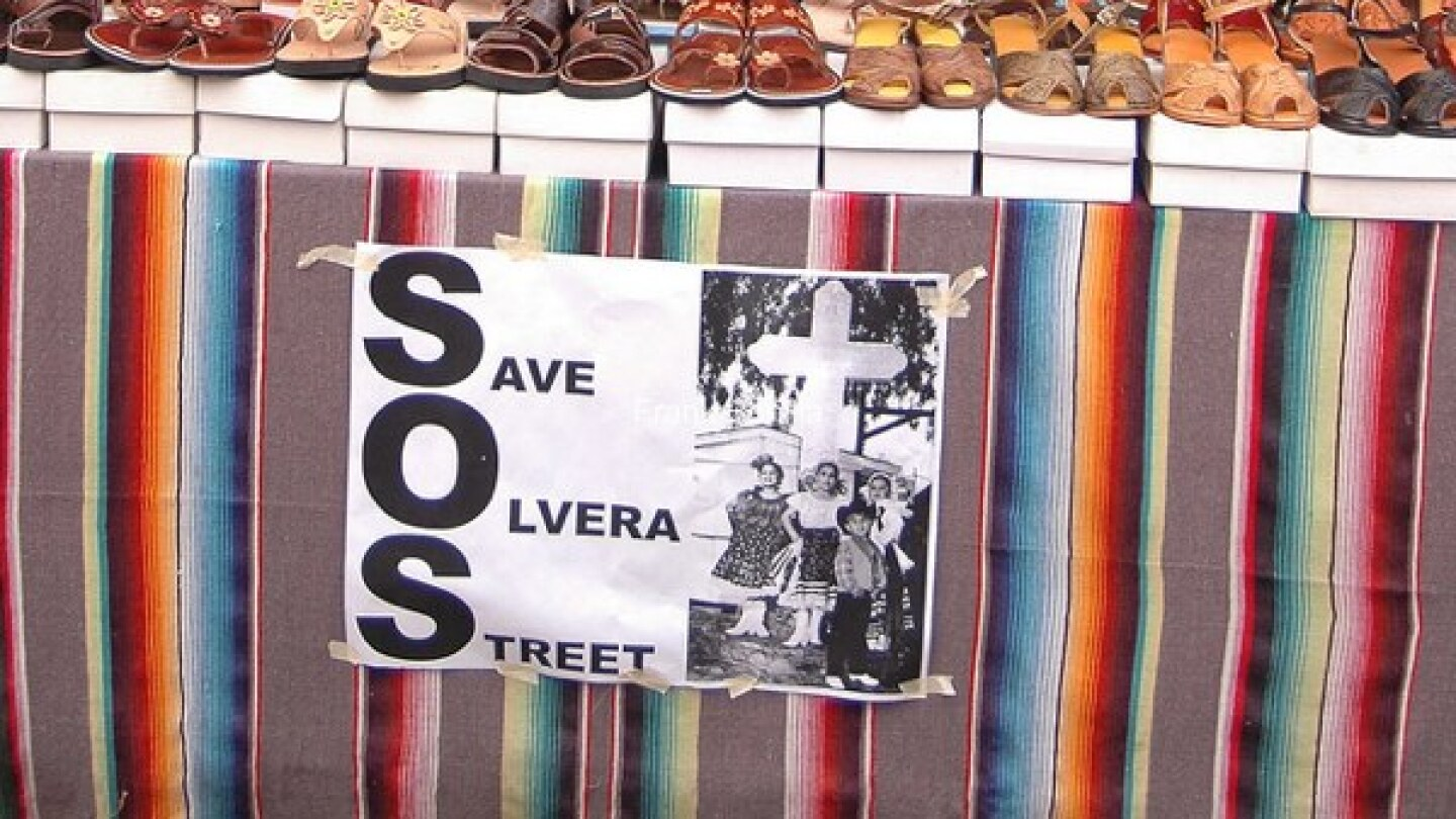 A 'Save Olvera Street' sign seen in 2010 as merchants and the city negotiated rent prices