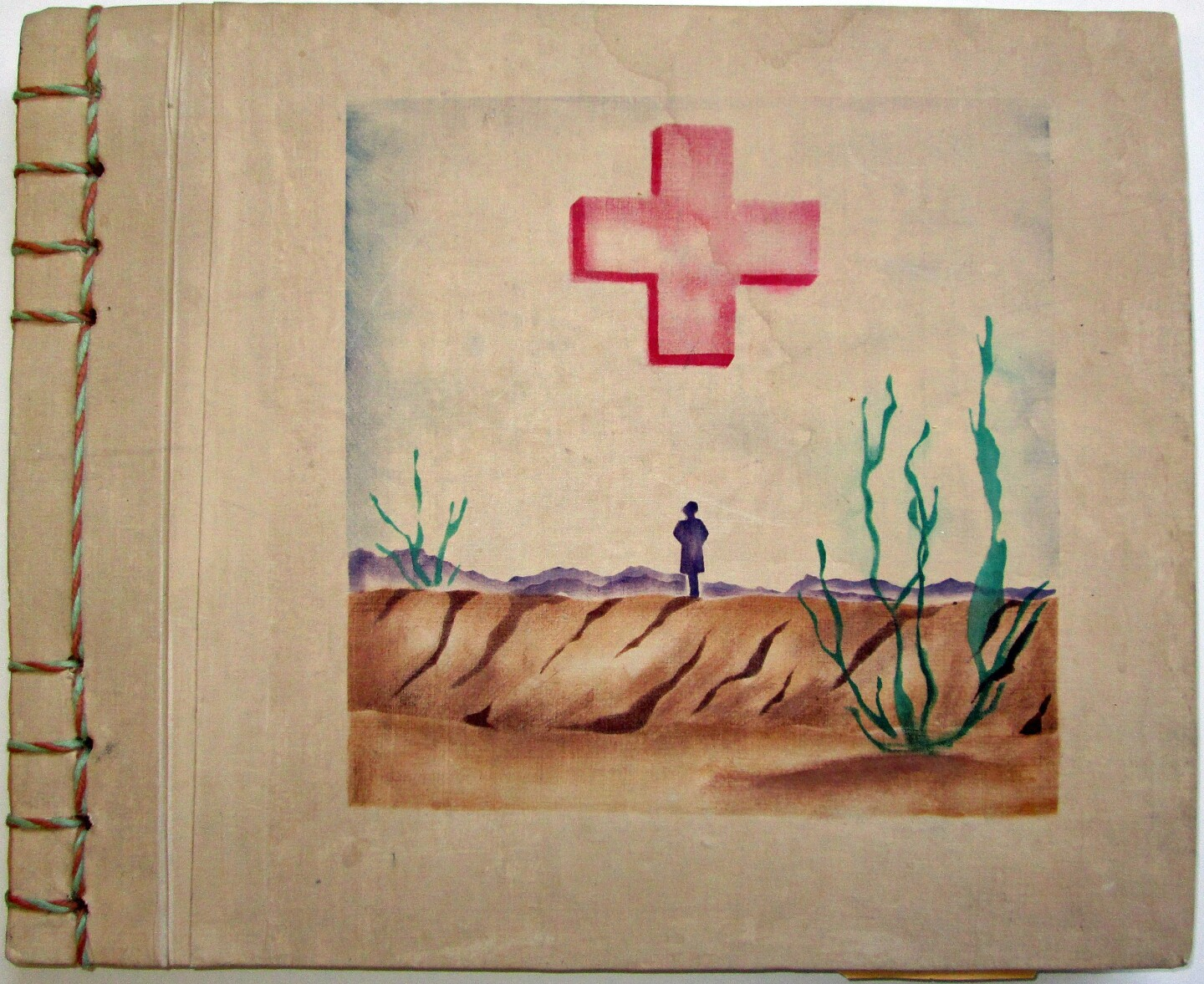 Poston scrapbook cover featuring the American Junior Red Cross. | Courtesy of Bill Bell