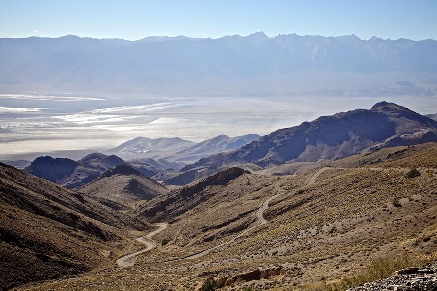 The old Yellow Grade Road (dust storm on Owens Lake below) - Cerro Gordo, CA - 2014 | Photo: Osceola Refetoff