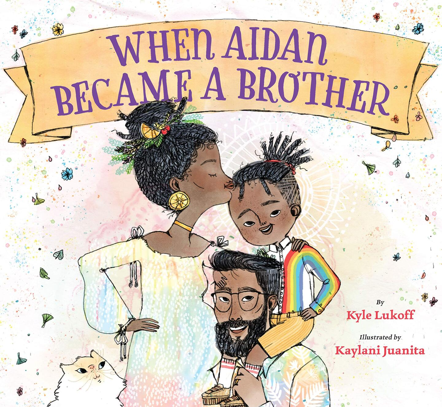 """Book cover of """"When Aidan Became a Brother"""" written by Kyle Lukoff and illustrated by Kaylani Juanita featuring an illustration of a Black family. The father is holding a child in a rainbow shirt on his shoulders while the mom is kissing the child's forehead."""