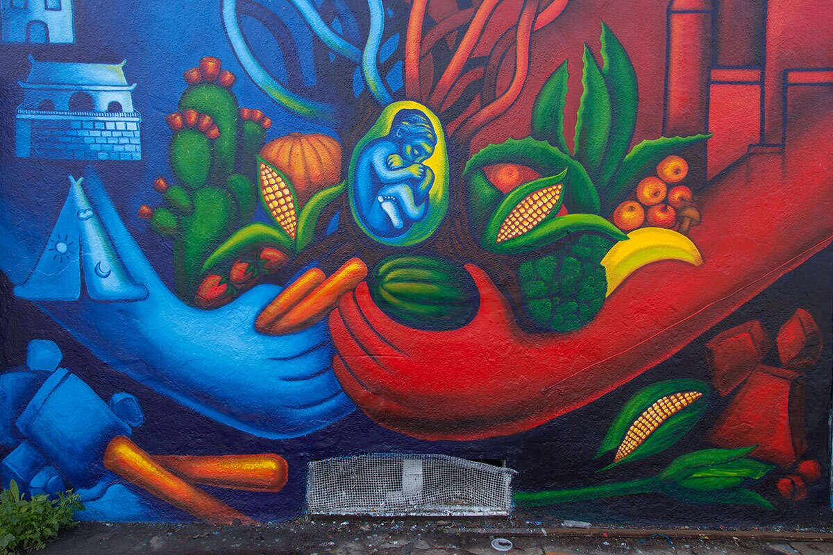 """""""blue and red sky with baby (Avalon Alley Murals, 2016)"""" by Noni Olabisi."""