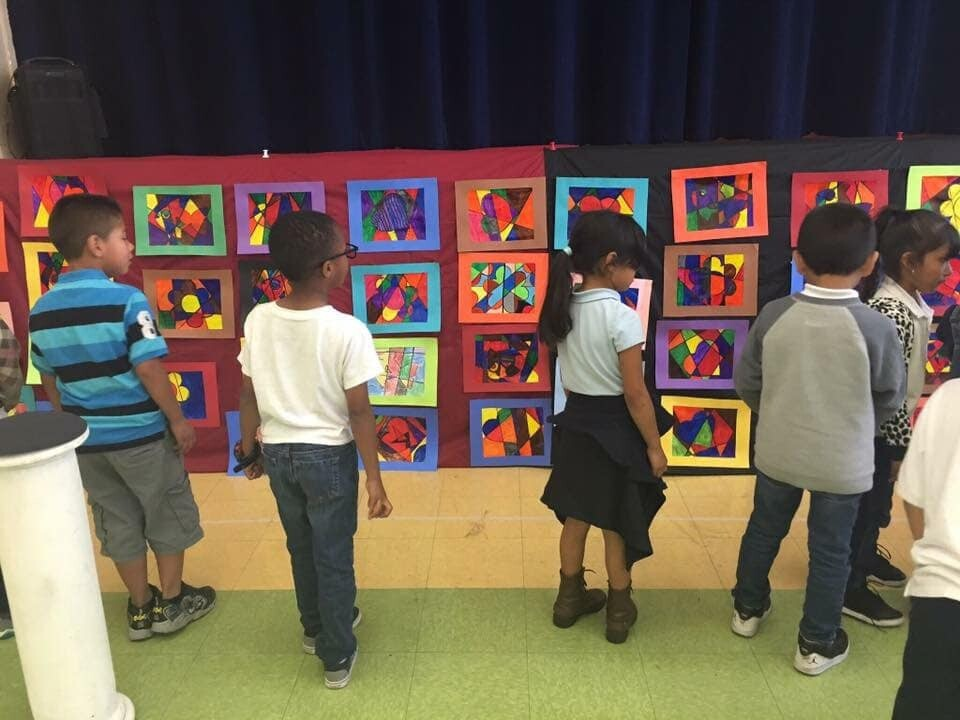Students observe their work for a visual arts festival at McKinley K-8 School of Integrated Arts.