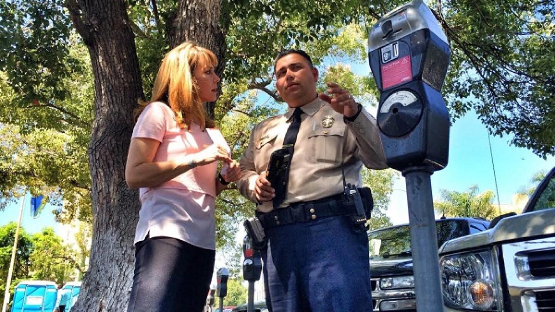 Jennifer Sabih speaks with LADOT Officer Enrique De La Cruz for a segment of KCET's 'SoCal Connected' | Photo: Zach Behrens/KCET