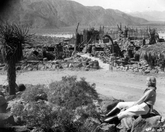 The Araby rock house called Casa Contenta. The woman is possibly an early owner named Perle Wheeler Martin. | Security Pacific Bank Collection/Los Angeles Public Library.