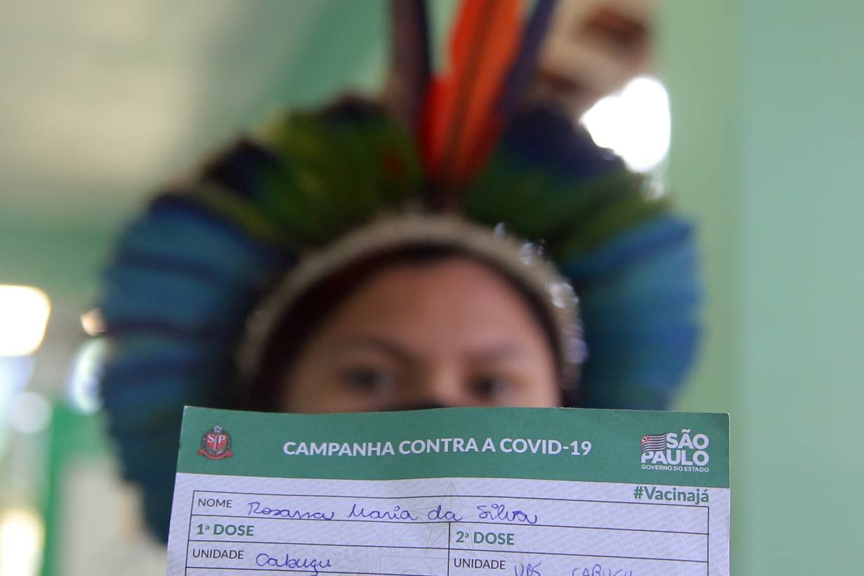 An Indigenous woman shows her vaccination card after receiving the second dose of Sinovac's CoronaVac coronavirus disease (COVID-19) vaccine at a health station.