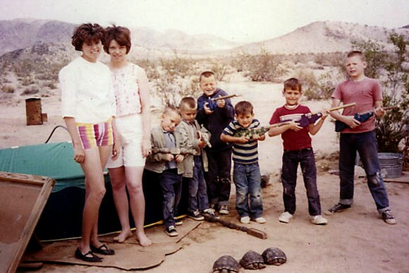 "A 1950s homesteading family with three of their ""pet"" tortoises in Twentynine Palms. 