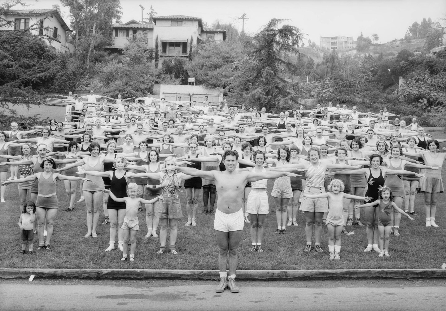 Bragg leads his Wanderlusters in a post-hike workout in Griffith Park, 1932. Courtesy of the USC Libraries - Dick Whittington Photography Collection.