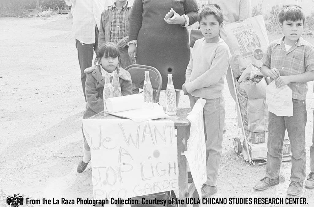 CSRC_LaRaza_B12F16C1_STAFF__021 Children petition for a traffic light at the corner of Fourth Street and Pecan Street in Los Angeles | La Raza photograph collection. Courtesy of UCLA Chicano Studies Research Center