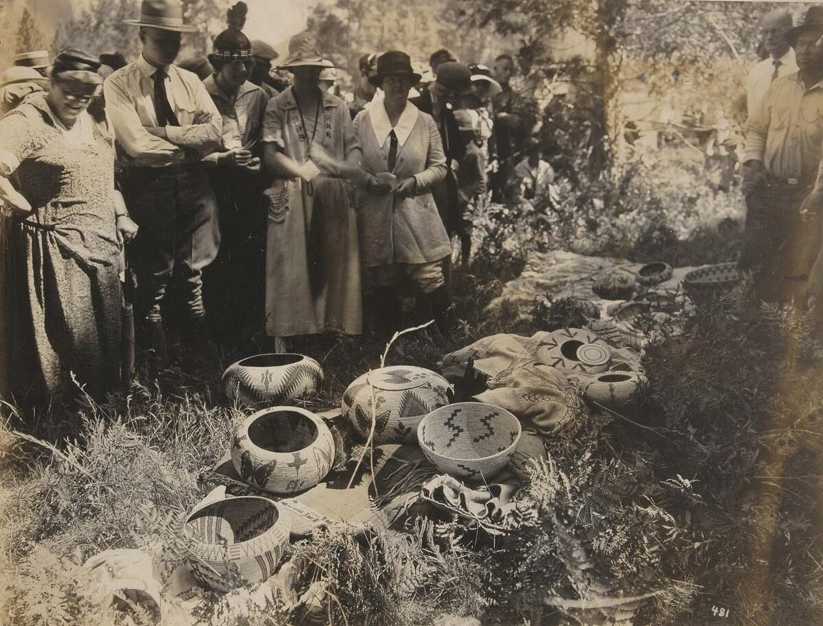 Judges inspective basket display. Yosemite's Annual Indian Field Days, Aug. 1-2, 1924. | Autry Museum of the American West Collection.