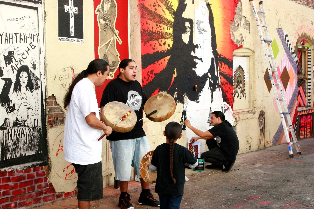 Artist Votan Henriquez works on a vibrant mural in Indian Alley. | Photo: Pamela J. Peters