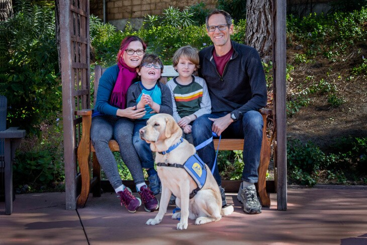 From left to right: Kelley, Aaron, Sean and Eric Coleman. Six-year-old Aaron is a kindergartener at Coldwater Canyon Elementary who receives special education services. In the foreground is Aaron's therapy dog, Heddie. | Courtesy of the Coleman family
