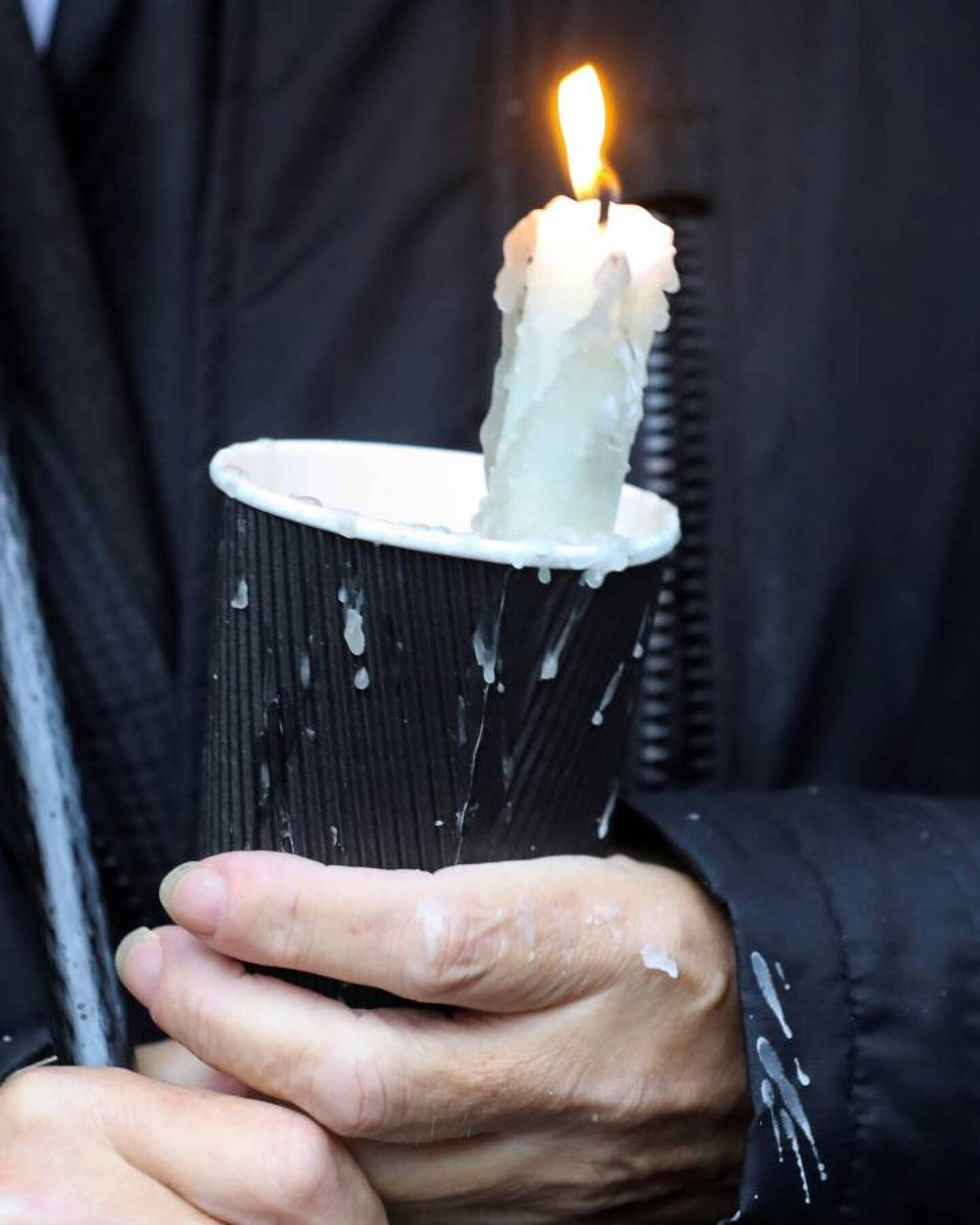 A mourner holds a candle outside St Eugene's Cathedral in Londonderry, Northern Ireland August 4, 2020. | REUTERS/Lorraine O'Sullivan