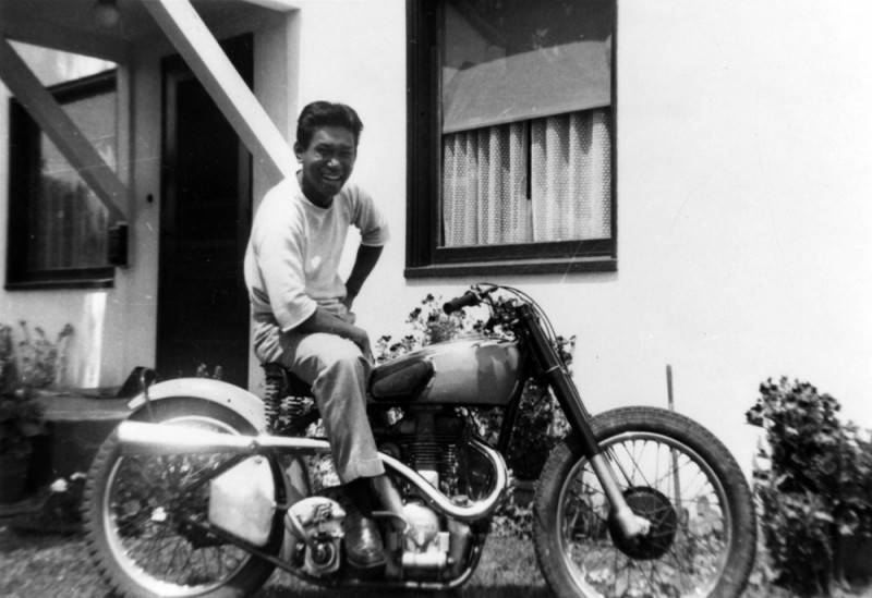 Black and white image of a man on a motorcycle