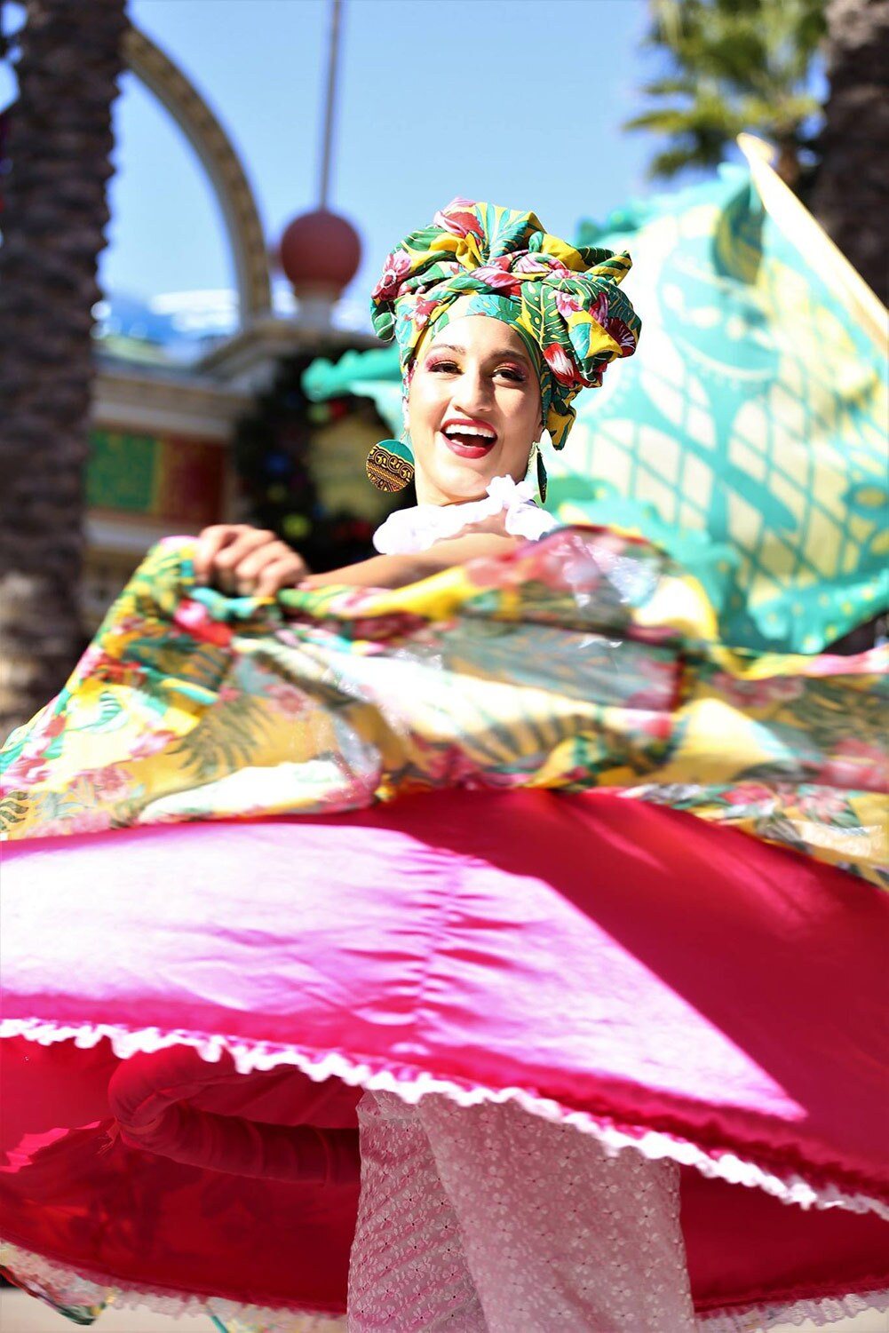 A colorful dancer in swirls of color during Disney California Adventure Park's ¡Viva Navidad! Street Party parade | Courtesy of Viver Brasil