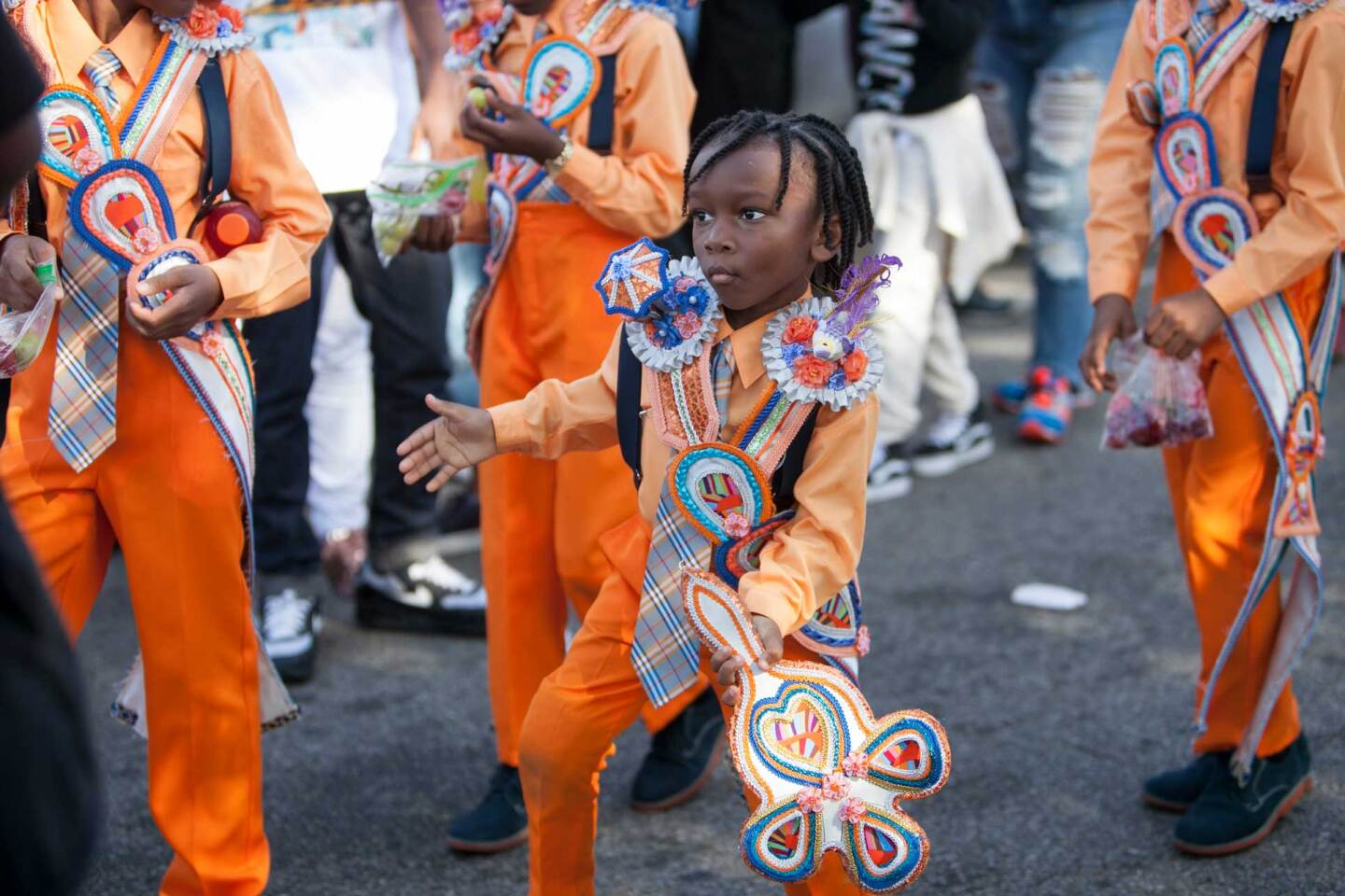 A young boy wearing colorful regalia participates in a New Orleans parade. | Nicky Milne/Thomson Reuters Foundation