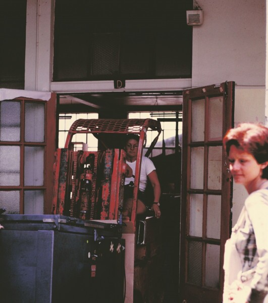 Cheryl Swannack moves the Woman's Building printing press from Grandview to Spring Street, July 25, 1975. Arlene Raven looks on. | Image permission: Otis College of Art and Design Library