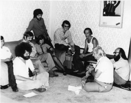 Left to right: John Platonia, Jim Kepner (moustache), Howard Fox (standing), June Herrle, Jim-Ed Thompson, Ralph Schaeffer, Morris Kight, Don Kilhefner (far right) and another person at the Gay Community Services Center, 1971. | Pat Rocco