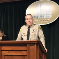 Sheriff Alex Villanueva at podium at press conference talking about transparency in his department