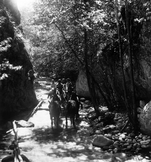 A four-horse carriage is seen in the narrows, North Fork Canyon of the San Gabriel Mountains. | Courtesy of the Los Angeles Public Library