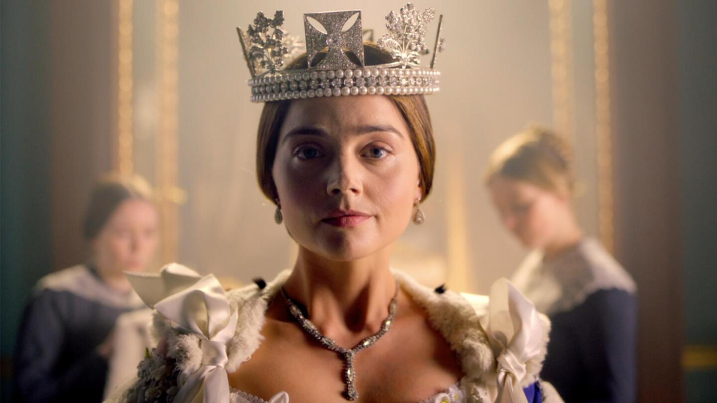 """Queen Victoria (Jenna Coleman) looks directly into the camera. 