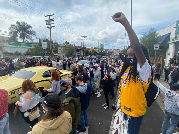 In Silver Lake, revelers celebrate the news that Joe Biden and Kamala Harris have been declared the next president and vice-president of the U.S. on Saturday, Nov. 7, 2020. | Kyle Stokes/LAist