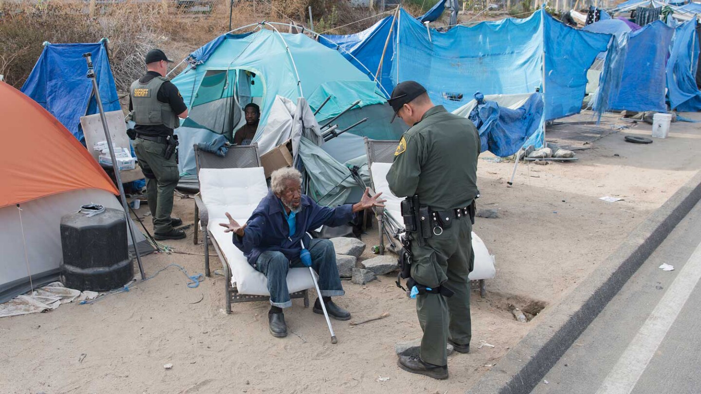 O.C. Sheriff's Deputies question homeless camp resident