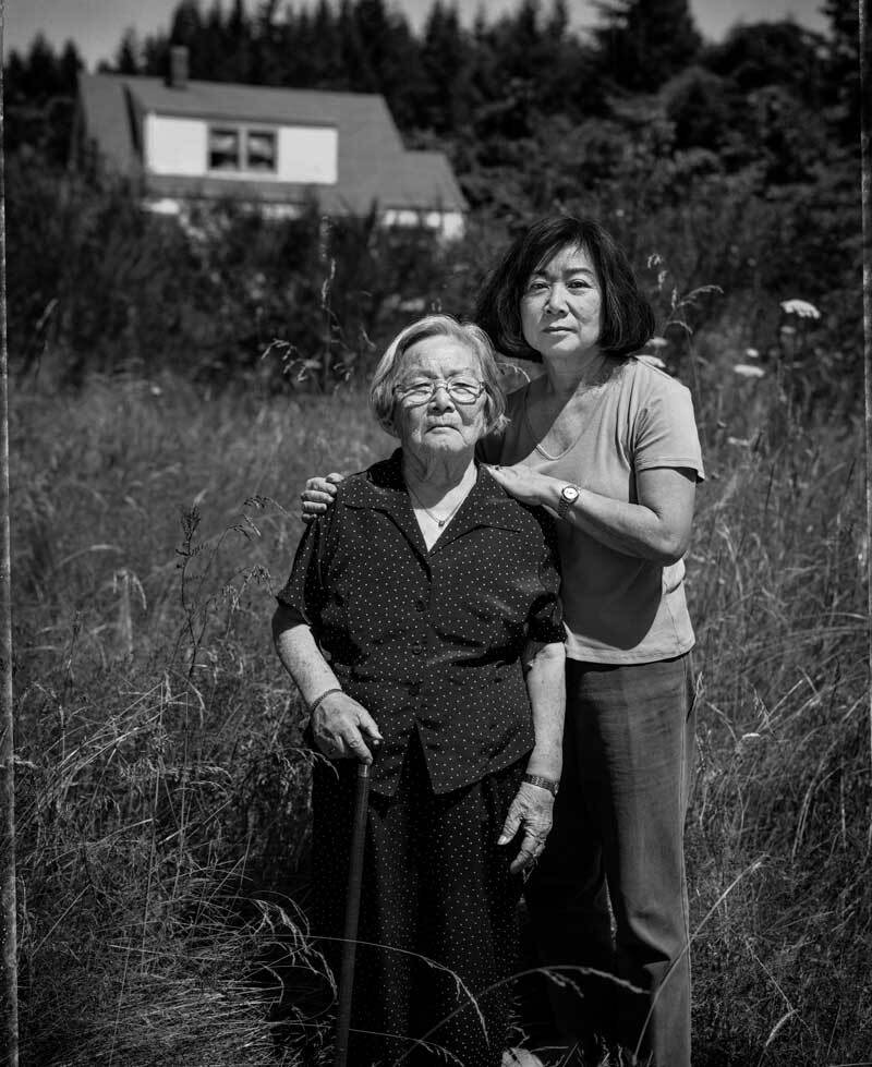 Fumiko Hayashida, 95, and her daughter Natalie Ong, 66, on the family farm where they lived before their forced removal from Bainbridge Island in 1942.  Paul Kitakagi, Jr.