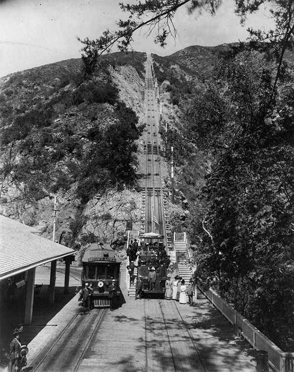 View of Mount Lowe's cable incline at the Rubio Pavilion. A group poses in the car at the bottom of the incline. | Courtesy of the Los Angeles Public Library