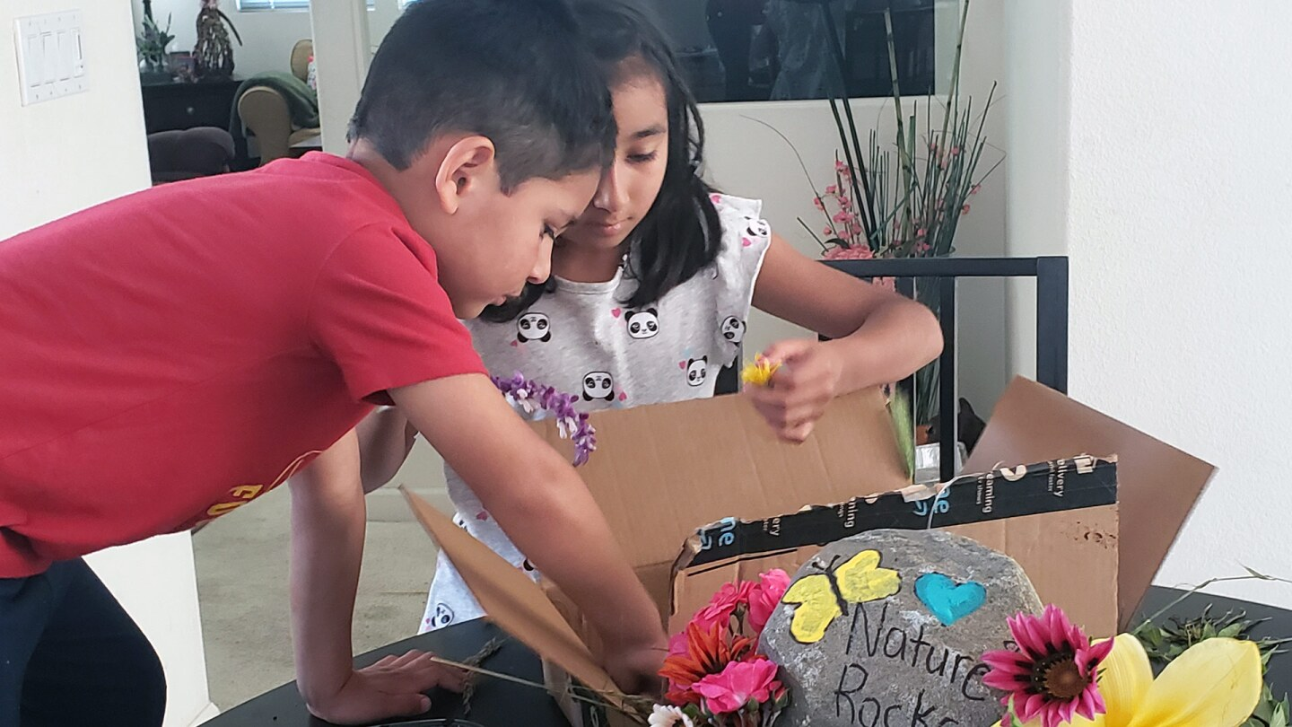 The Padilla children work on their nature-themed float for the virtual Rose Parade. | Courtesy of David Eads