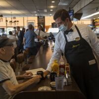 A server waits on a customer at Langer's Deli in Los Angeles, California