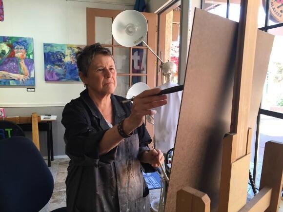 Artist Kate Moldauer works on a painting. | Photo: Paula McCambridge.