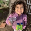 Miguel Ordeñana's daughter holding up a jar with an earthworm in it | Natural History Museum of Los Angeles County. Courtesy of Miguel Ordeñana