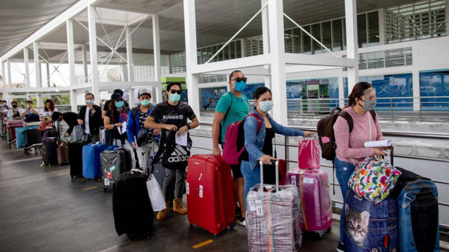 Repatriated Overseas Filipino Workers or OFWs arrive at an airport after being allowed to go home following weeks of quarantine amid the spread of the coronavirus disease (COVID-19), in Pasay City, Metro Manila, Philippines May 26, 2020. REUTERS