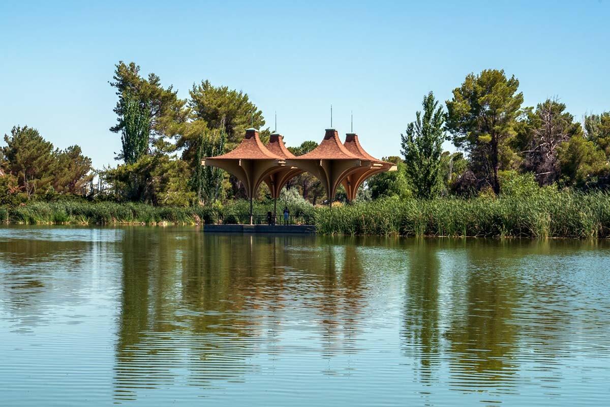 "The lake pavilion's unusual geometric ""parasol"" architectural flourishes were incorporated into the development's logo.   Kim Stringfellow"