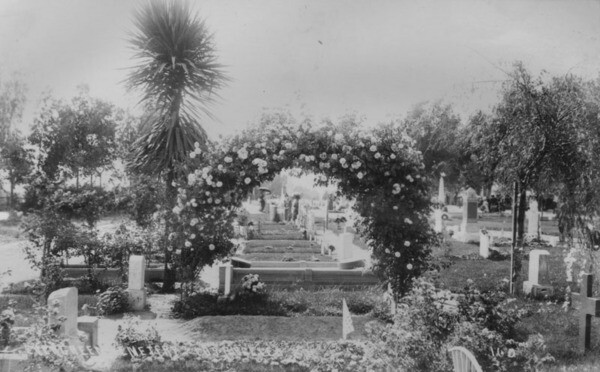 A row of freshly filled graves at Evergreen Cemetery | Security Pacific National Bank Collection, courtesy of the Los Angeles Public Library